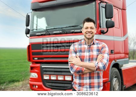 Portrait Of Driver At Modern Truck Outdoors