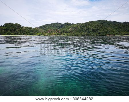 Beautiful crystal clear water with healthy coral reefs undersea from surface of Gaya Island, Tunku Abdul Rahman Park, Kota Kinabalu. Sabah, Malaysia. Borneo,