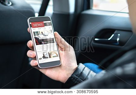Person Reading Online News With Mobile Phone. Newspaper Website Mockup On Smartphone Screen. Man Enj