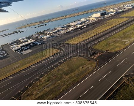 Honolulu - October 25, 2018: Aerial Of Airport Runway, Planes And Plane Hangers At Honolulu Internat