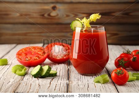 Tomato Juice From Fresh Tomatoes And Celery Stalks With Juicy Tomatoes, And Slices Of Sliced Cucumbe