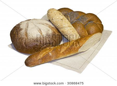 Black Round Bread, Rich Wattled Roll  And Two Baguettes On The Linen Napkin.
