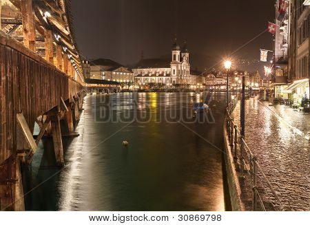 Chapel Bridge (Kappelbr�cke) with Jesuit Church at night, Lucerne, Switzerland