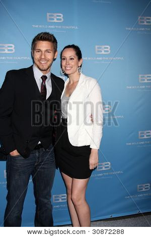 LOS ANGELES - MAR 10:  Scott Clifton; Nicole Lampson arrives at the Bold and Beautiful 25th Anniversary Party at the Perch Resturant on March 10, 2012 in Los Angeles, CA