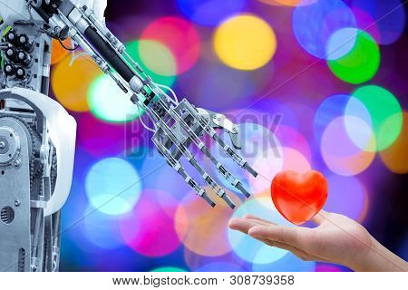 Human Heart On Hand Send To An Artificial Robot In Valentine Day For Make The Robots Have Love Like