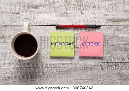 Text sign showing Together Everyone Achieves More. Conceptual photo Members create synergy with strong sense mutual commitment Stationary placed next to a cup of black coffee above the wooden table. poster