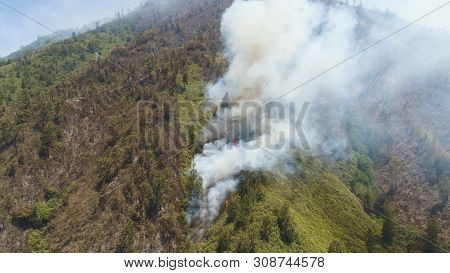 Aerial View Forest Fire Smoke On The Slopes Hills. Fire In Mountain Forest. Wild Fire In Tropical Fo