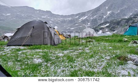 Tents During Hail And Cold Rain In Summer, Midday At Lake Bucura, Retezat Mountains. View From Insid