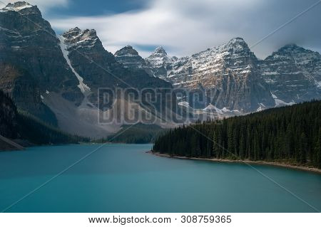 The Majestic Moraine Lake At Banff National Park, Canada, Shot On A Long Exposure To Smooth Out The