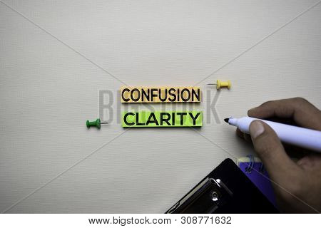 Confusion Or Clarity Text On Sticky Notes With Office Desk Concept
