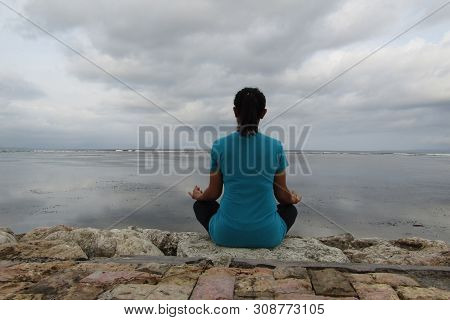 Meditation. Woman Meditating From The Back, Relaxing In Yoga Pose In The Beach, Zen Meditation. Huma