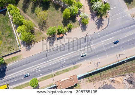 Asphalt Road Passing Through An Suburb Industrial Area. Birds Eye View