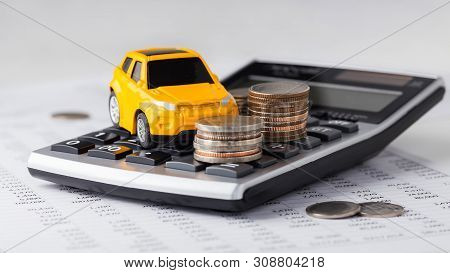 Car And Coins On Calculator