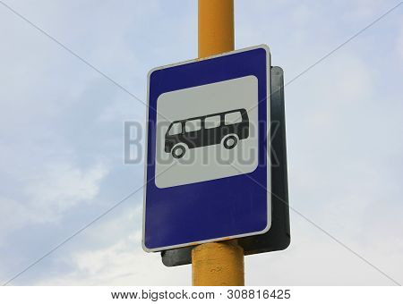 Bus Stop Sign On City Street. Public Transport Stop Signal With Local Buses