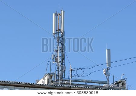 Antenna Equipment For Mobile Cellular Telephony On The Roof Of A Residential Multistory Urban Buildi