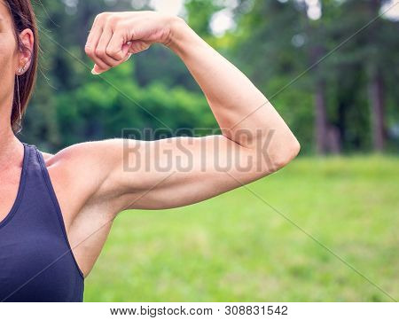 Fit Muscular Young Woman - Strong Bodybuilder Outdoor