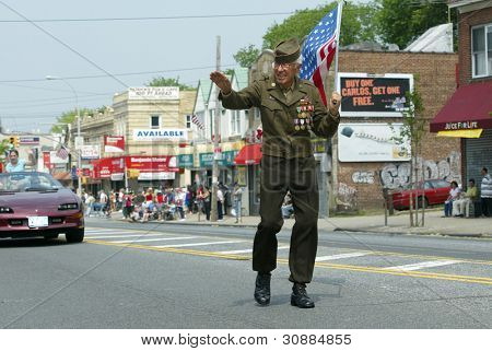 NEW YORK - MAY 29:  An unidentified veteran waves as he marches in the Little Neck/Douglaston Memorial Day Parade May 29, 2006 in Queens, NY.