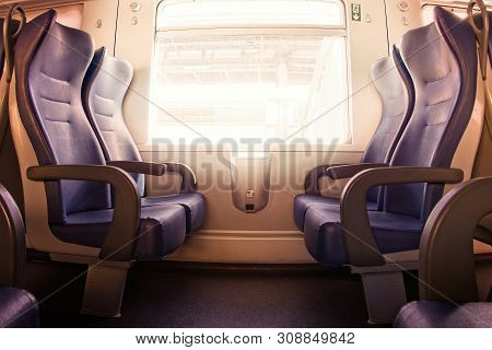 Interior Of A Passenger Train With Empty Seats.