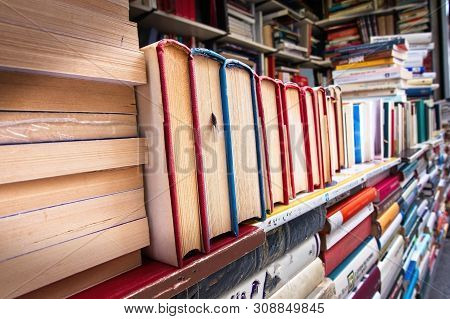 Piles Of Old Book  On A Stall.