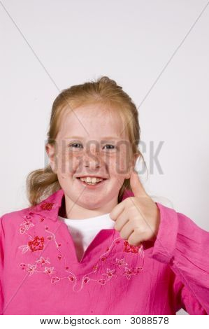 Cute Little Girl With Thumb Up