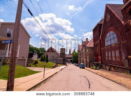 Braddock, Pennsylvania, Usa 6/29/2019 A View Of Parker Avenue Looking Towards Library Street On A Br
