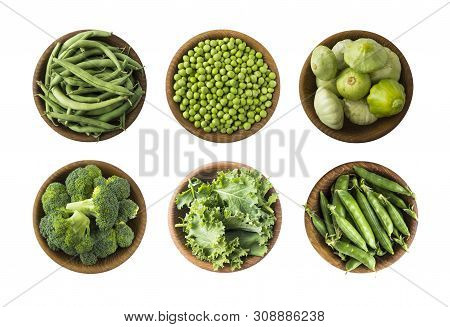 Fresh Green Vegetables Isolated On A White Background. Squash, Green Peas, Broccoli, Kale Leaves And