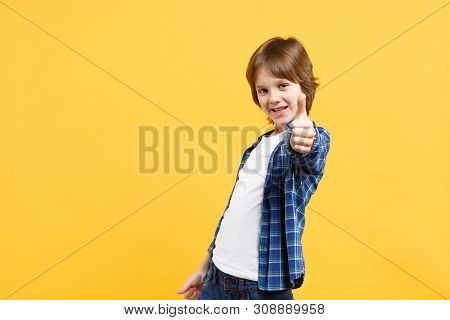 Fun Cheerful Happy Little Kid Boy In Blue Shirt White T-shirt Posing Gesturing Hands Isolated On Yel