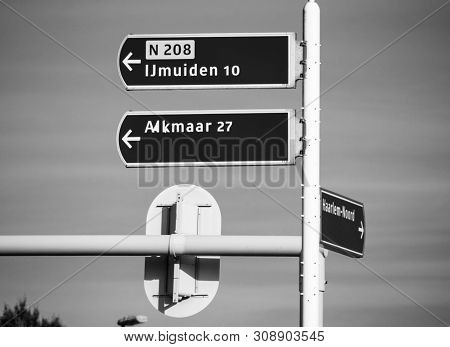 Futch Street Highway Sign With Directions To Ijmuiden, Alkmaar, - Clear Sky Inthe Background - Black