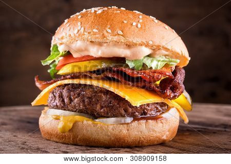 A Delicious Homemade Bacon Cheeseburger With Real Cheddar Cheese, Lettuce, Onion, Tomato, Pickle, Mu