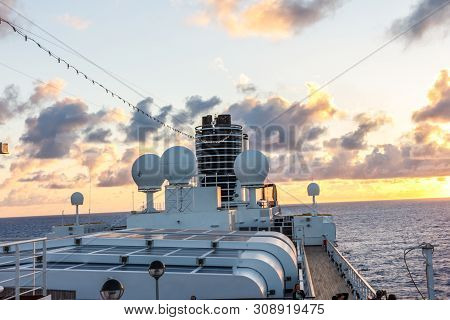Funnel And Navigational Aids On A Cruise Ship At Sea At Sunset.