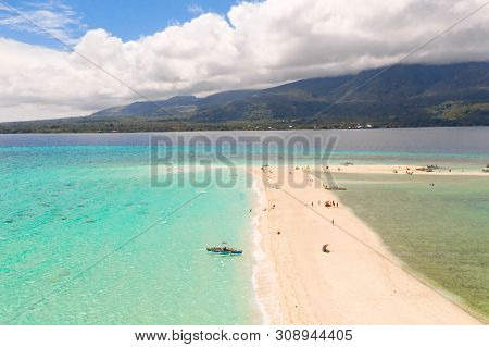 White Beach Overlooked By Volcanos On Camiguin Island Near Mindanao In The Philippines. Tourists Res