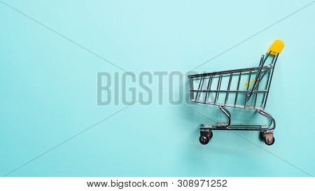 Shopping Cart On Blue Background. Top View Or Flat Lay. Shop Trolley At Supermarket As Sale, Discoun