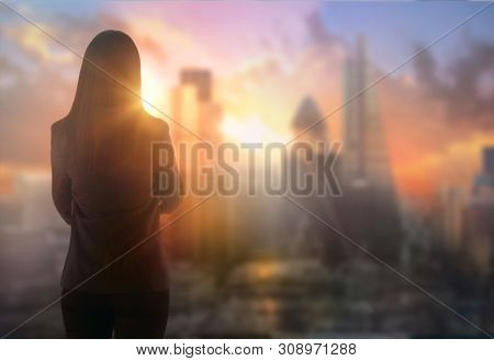 Young Woman Looking Over The City Of London, Business And Banking Area With Skyscrapers At Sunset. F
