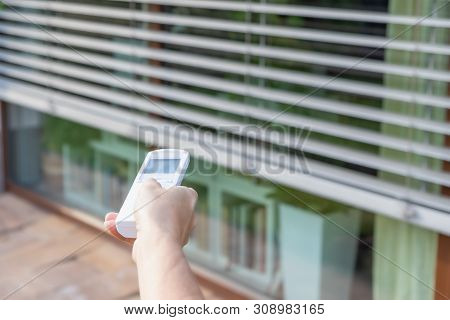 Control The External Window Blinds With The Remote Control. Vertically.