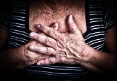 Close up of an old woman's hands over her chest poster