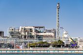 Chemical Factory plant with gas storage and structure of pipeline with smoke from smokestack in Kawasaki City near Tokyo Japan poster