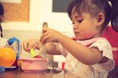 asian baby girl pretend play food toy poster