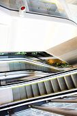 moving grey escalator in the office hall poster