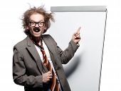 Crazy professor / scientist / lecturer with mad hairstyle wearing horn rimmed glasses and fake mustache standing in front of a whiteboard and pointing it with happy goofy face poster