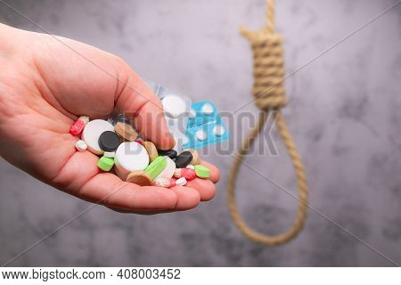 Taking Of Antidepressants. Getting Rid Of Suicidal Thoughts. Hand With Handful Of Various Pills On B