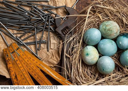 Colorful Handmade Easter Eggs On Paper With Old Hands Tools. Easter Card Design.