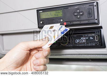 Olomouc Czech Rep Jan 5th 2021 Hand Holding A Driver Digital Card, Bank Debit Card And Drivers Licen