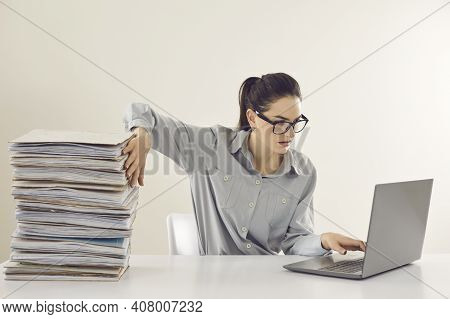 Accountant No More Needs Piles Of Papers And Is Working With Electronic Documents On Laptop