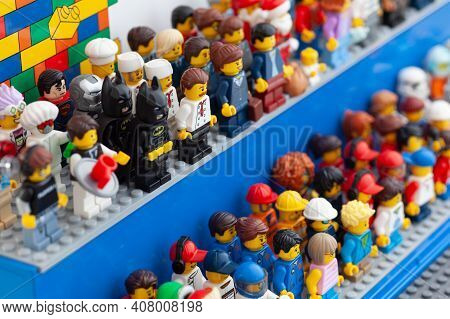 Tambov, Russian Federation - February 12, 2021 Lego Minifigures Standing In A Display Case.