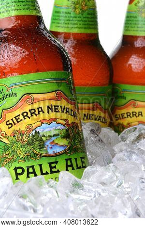 IRVINE, CA - MAY 30, 2014: Closeup of Sierra Nevada Pale Ale bottles in ice. Sierra Nevada Brewing Co. was established in 1980 by homebrewers in Chico, California.