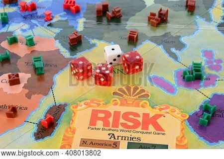 IRVINE, CA - MAY 19, 2014: Risk board game closeup. Risk is a strategy game where the objective is to occupy every territory on the board thereby eliminating the other players.