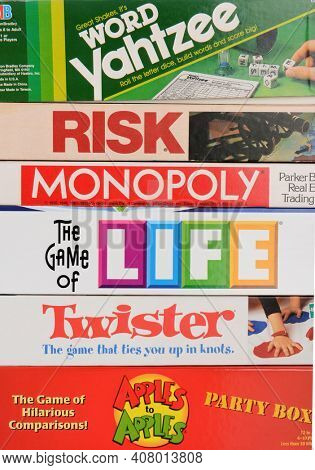 IRVINE, CA - May 19, 2014: A stack of Family Board Games. Classic games from Parker Brothers and Milton Bradley, including Monopoly, Twister, Life, Risk, Yahtzee and Apples to Apples.