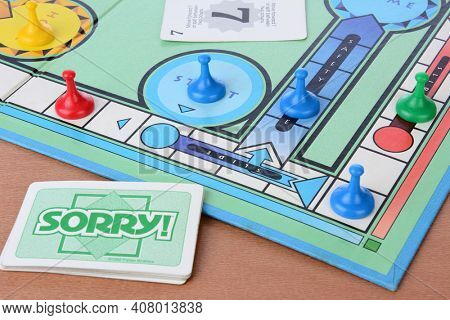 IRVINE, CA - MAY 19, 2014: Sorry! board game closeup. Sorry! is a game based on the ancient Cross and Circle game Pachisi. The game is made by Parker Brothers a Division of Hasbro.