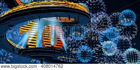 Number 10 Formed By A Yellow Structure On A Round Metal Platform Illuminated By 8 Reflectors Surroun