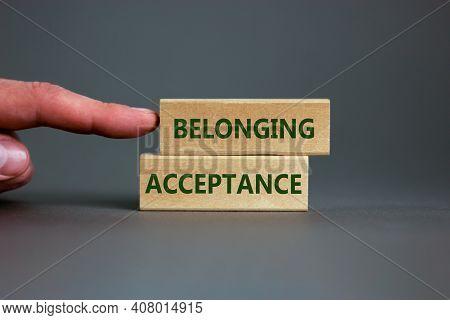 Acceptance And Belonging Symbol. Wooden Blocks With Words 'acceptance And Belonging' On Beautiful Gr